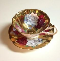 Queen Anne Tea Cup and Saucer Gold & Roses by vicky