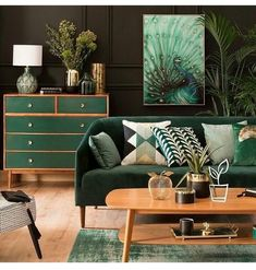 Modern Green Scandinavian living room with a green velvet couch and wooden details.