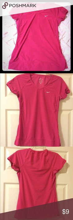 "Nike Dri Fit like new top Like new pink Nike dri fit v-neck, short sleeve athletic top. Polyester/elastine. Banded sleeves. White logo on chest. L- 24"", W- 15.5/16"" (pit to pit) Nike Tops Tees - Short Sleeve"
