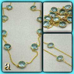 Gemstone jewelry. 14K gold necklace with handset blue topaz. Fancy cut gems and luxurious precious metals. amazinite. New fashion revolution.  http://stores.ebay.com/amazinite