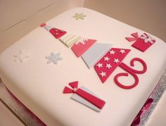 White square Christmas cake with tree in the middle in red and silver.JPG