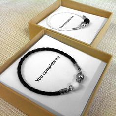 Couples Jewelry, His And Her Bracelet, His and Hers Gifts, Love Couple Bracelet, Couple Gifts, Matching Bracelets, Love Bracelets,Friendship    A great gift for couples! The product here is a set of two bracelets for him and for her. The bracelets are packed in a box with a card inside with the words: You complete me.   MATERIAL AND SIZE Black and white leather like, black Lava bead and white Coral bead . The bracelets clasp is a magnet. Bracelet for men: Black leather like with one white…