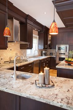 Possibility for Jeremy's kitchen ~~~~~~~~ Giallo Ornamental granite countertops dark wood cabinets stainless steel appliances - sleek modern hardware Dark Brown Cabinets, Cherry Wood Cabinets, Dark Wood Kitchen Cabinets, White Cabinets, Espresso Cabinets, Corner Cabinets, Kitchen Ideas With Brown Cabinets, Hickory Cabinets, Colored Cabinets