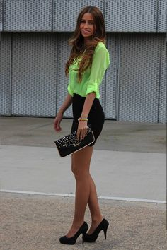 neon top black skirt and clutch