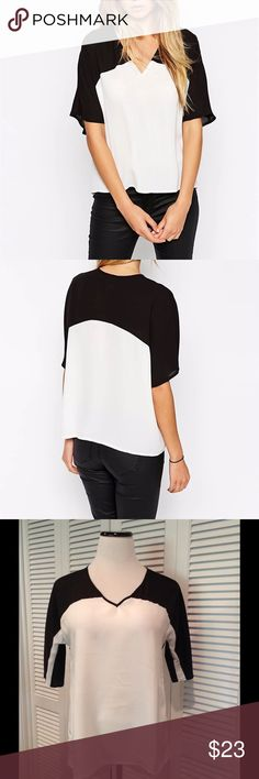 """Color block blouse New! Color block slightly sheer top. Classic black and white and so stylish! Boutique brand. Three sizes available! S: 18""""UA 24""""L  M: 19""""UA 24""""L L: 20""""UA 24""""L Tops Blouses"""