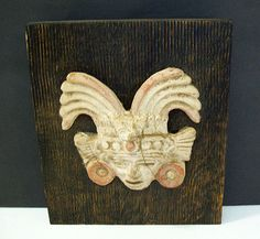 A Pre-Columbian artifact in the Teotihuacan style mounted on wood by Los Castillo during the mid-century in Taxco.  Signed Los Castillo Taxco. Antonio Castillo collected many fine pieces of Pre-Columbian art and often used artifacts in his designs.