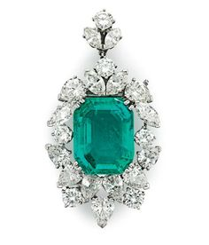 A 13.95 carats Colombian emerald and diamond pendant-brooch