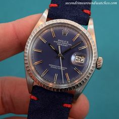 A 1972 Rolex Datejust Reference 1603 with a blue dial with applied steel baton marksrs, a stainless steel fluted bezel and watch case and a 26-jewel, caliber 1530 automatic-wind movement. This piece also comes strapped with a new, 20mm Sueded Genuine Leather Blue-colored watch strap with contrasting Red Stitching! (Store Inventory # 10289, listed at $3500, available for purchase online and in store.) #rolex #blue #dial #datejust #steel #mens #vintage #watches #watch #classic #wristwatch