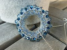 Originally titled: Golden Sun.  I have no clue why since it's a blue beaded donut.  Still lovely.