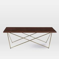 Waldorf Coffee Table | West Elm - rosewood finish probably won't look good with dark floors, but i love the geometric base - $499