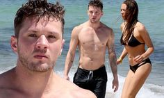 Ryan Phillippe shows off sculpted physique at beach with girlfriend