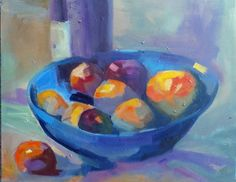 Oranges and Nectarine in a blue bowl with a bottle of wine in the background - of course!