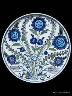 Dish    Location:  London, England, United Kingdom    Holding Museum:  Victoria and Albert Museum        Date of Object:  About hegira 957 / AD 1550    Height 4.5 cm, diameter 33.6 cm  Period / Dynasty Ottoman  Provenance: Iznik, Turkey.