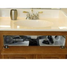 use the annoying FAKE drawer in front of the sink.