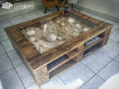 #LivingRoom, #PalletCoffeeTable, #RecyclingWoodPallets I made this Beachy-Keen Pallet Coffee Display Table using six pallets and did it for under 60 bucks. The idea was to make a small coffee table with a space in the center. We wanted a place to display some beach shells we'd collected. For the