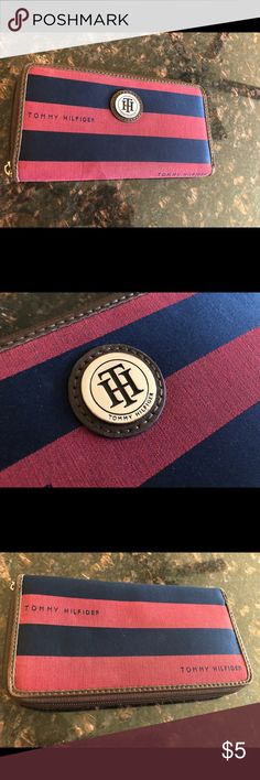 💞 Tommy Hilfiger Wallet navy/pink. Clean and like new on the inside. The outside is in Acceptable condition, one stain the size of a thumb on the bottom. Zipper works but needs a pin or string for better grip. I took pictures of all flaws. Bundle and I can lower price even more! Tommy Hilfiger Bags Wallets