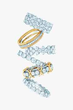 Tiffany Celebration® rings in platinum with diamonds, from top: Tiffany Swing, Tiffany & Co. Schlumberger® Rope two-row in 18k gold, Tiffany Aria, Tiffany Jazz™, Tiffany & Co. Schlumberger® Sixteen Stone in 18k gold, shared-setting band. #TiffanyPinterest