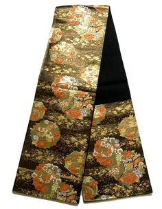 This is a zestful Fukuro obi with seasonal flowers such as 'kiku'(chrysanthemum), 'botan'(peony) and 'ume'(Plum blossoms) pattern, which is woven