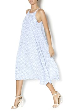 A loose and flowy midi dress in a gorgeous periwinkle with an all-over white trellis print. Features a keyhole and button closure in the back, and thin spaghetti straps. Fully lined. Perfect for springtime picnics and shopping trips. Pair with a loose cardigan and sandals for a pretty, casual look!