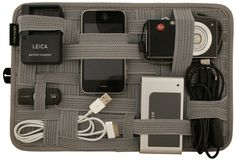 AWESOME for packing your gadgets. Its called the Grid-it.