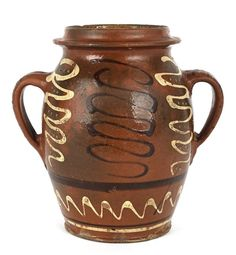 Sold $ 1,900 Bucks County, Pennsylvania, redware two-handled crock, 19th c., with yellow and manganese slip squiggle lines, 8'' h.