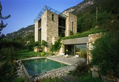 beautiful stone houses | ... built into a slope grounded in a stone heavy design this stone house