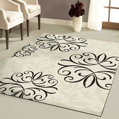 Orian Ironfluer Rug, Cream @ Wal Mart  - on rollback for 63x90 for $59.00