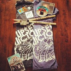 Who wants an official #theupsetvictory fan pack? Give us a shout out on your #instagram or #Pinterest account and you'll be entered to win! Just tag us in your post and type your email below this picture. 2 lucky #winners will be drawn when we reach 3,000 followers! #prize #shoutout #band #bandshirt #music #scene #fan #giveaway #free #autograph #drumsticks #cd #guitar #merch