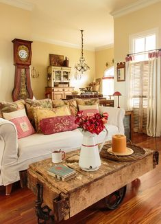 French country. Warm colors, wood, white couch