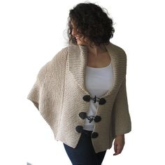 Plus Size Hand Knitted Ecru Poncho With Leather Rope by Afra ($96) ❤ liked on Polyvore featuring outerwear, black, sweaters, women's clothing, poncho cape, leather poncho, plus size poncho, black leather cape and plus size cape