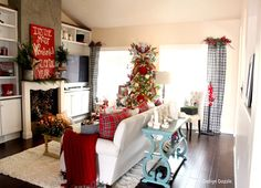 It's the most wonderful time of the year home tour - Design Dazzle NOTE: check how the greens are attached to the drapes Christmas Living Rooms, Christmas Room, Christmas Holidays, Christmas Ideas, Holiday Ideas, Christmas Decorations, Primitive Christmas, Rustic Christmas, Large Christmas Tree
