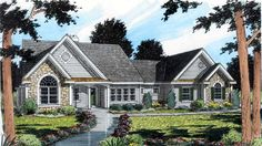 Columns define the entrances from the foyer into the common areas in the Cottage style home.  Cottage House Plan # 391428.