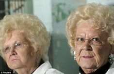 Mearl Anglin Taylor, right, and her sister Marie Anglin Widner discuss their brothers' escape from Alcatraz Island's federal prison in the San Francisco Bay