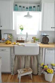 love the idea of shelf above kitchen sink.  I could place my cookbooks there.