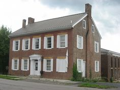 Mercer County Jailer's Residence, located at 320 S. Chiles Street in Harrodsburg, Kentucky. Built in 1827, it is listed on the National Register of Historic Places. Note the equally-old but heavily-modified jail behind the house.