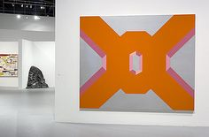 """Miriam Schapiro, Big Ox No. 1, 1968, """"Her painting, Big Ox No. 1, from 1968, references Shrine series, however no longer compartmentalized. The center O takes on the symbol of the egg which exists as the window into the maternal structure with outstretched limbs. Big Ox No.1 was inspired by the thought of a large, imposing sense of landscape coming toward the viewer and inviting him to become part of it. It could actually be viewed as Miriam's first feminist painting. The letter O is…"""