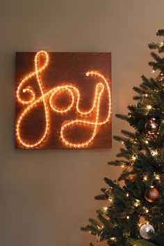 You can make this impressive holiday lighted sign with supplies from one quick visit to The Home Depot! Find everything you need to make one for your home here.