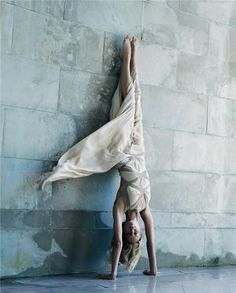 """Models of the Moment"" Karolina Kurkova in Adho Mukha Vrkasan, also known as handstand pose for photographer Steven Meisel from a shoot for American Vogue's September 2004 issue. - Alexander McQueen #fashion #photography"
