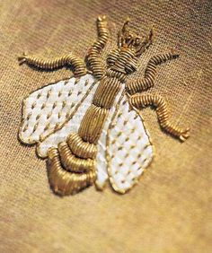 Antique embroidered bee, with gold thread!  Call A1 Bee Specialists in Bloomfield Hills, MI today at (248) 467-4849 to schedule an appointment if you've got a stinging insect problem around your house or place of business!