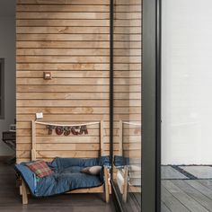 Striped wooden walls by the window. Designed by Siliviu. Get matched with the right design professional for your home project on www.designforme.com