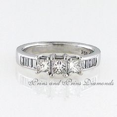 Centre diamond is a GH/VS – SI Princess cut diamond with 2 side princess cut diamonds and 8 x baguette cut diamonds channel set in an white gold shank Three Stone Rings, Princess Cut Diamonds, Shank, Baguette, Centre, Channel, Silver Rings, White Gold, Wedding Rings