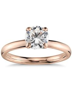 18k rose gold Monique Lhuillier engagement ring features a smooth wrapping around the center diamond of your choice | Monique Lhuillier Fine Jewelry | https://www.theknot.com/fashion/classic-solitaire-engagement-ring-monique-lhuillier-fine-jewelry-engagement-ring