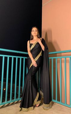 ₹1,349.00 Product Code: NEXF 102 Black Color: Black Set Content:1 Saree With Blouse Occasion: Party, Wedding , Daily, Events Etc. Saree Fabrics: Rangoli Silk Blouse Fabrics: Banglori Silk Saree Work : Embroidered Lace Border With Pipe & Sequence Lace On Pallu Saree Length: 5.5 mtr Blouse Length: 1 mtr Weight : 0.9 kg Expected Delivery: 4-6 working days Disclaimer:Actual Colors may vary slightly from the photograph Royal Anarkali #SAREES, #royalanarkali Indian Fashion Dresses, Dress Indian Style, Indian Designer Outfits, Ethnic Fashion, Fashion Outfits, Sari Dress, The Dress, Saree Blouse, Indian Wedding Outfits