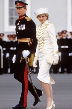Princess Diana - Fashion and Style Icon | British Vogue: April 1987 – Getting into the spirit of things, the Princess wore a military-style skirt suit by Catherine Walker paired with a white hat by Graham Smith at Kangol for an attendance at the passing out parade at Sandhurst.