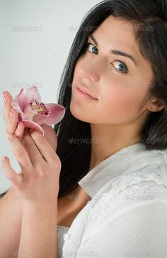 Beauty portrait of young, attractive, fresh, healthy and natural ...  attractive, background, beautiful, beauty, blossom, blue, brunette, care, caucasian, clean, close-up, complexion, cosmetics, cute, eyes, face, female, flower, fresh, girl, hair, head, health, healthcare, healthy, hygiene, joy, lifting, lily, lips, make-up, makeup, natural, nose, people, portrait, purity, scent, sensuality, sexy, skin, skincare, smell, smooth, spa, treatment, wellness, white, woman, young
