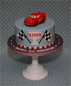 Oliver's mum just wanted a very simple racing theme cake with a Lightning McQueen figurine on top. Lightning McQueen was carved from styro (my first time carving styro…what a mess it was!) then covered with fondant. All details were hand painted. Racing Cake, Race Car Cakes, 3rd Birthday Cakes, Cars Birthday Parties, Lightening Mcqueen Birthday Cake, Gateau Flash Mcqueen, Lighting Mcqueen Cake, Cars Theme Cake, Disney Cars Cake