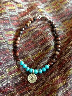 "Hand made Tribal Turquoise and Red Tiger Eye With Silver Charm ""Om"""