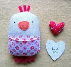 Molly Chicken has a wonderful tutorial for this cutie pie love bird that can hold little love notes and tokens in its pocket - so sweet!