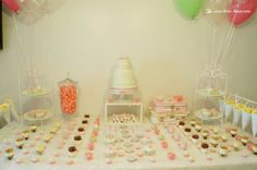 the dessert table for this light green and pink girl baptism party