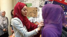 A group of university students have rekindled the heated debate over the acceptance of the Muslim veil in French society as they invited fellow classmates at the prestigious Sciences Po university to try on the garment.